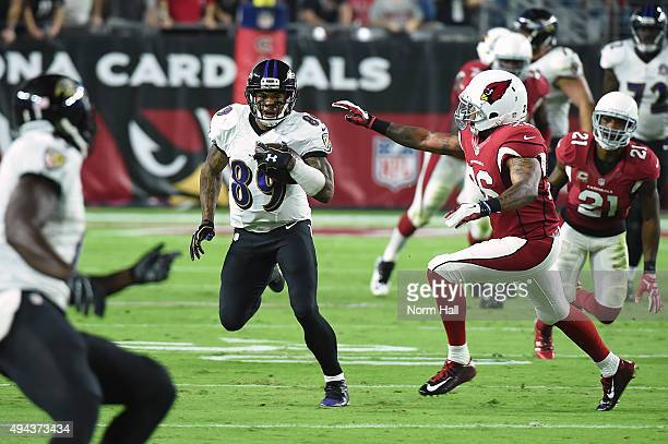 Wide receiver Steve Smith Sr #89 of the Baltimore Ravens rushes the football against free safety Rashad Johnson of the Arizona Cardinals in the first...