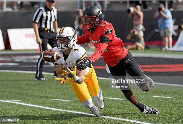 Wide receiver Tanner Gentry of the Wyoming Cowboys catches a 50yard pass against defensive back Kenny Keys of the UNLV Rebels during their game at...