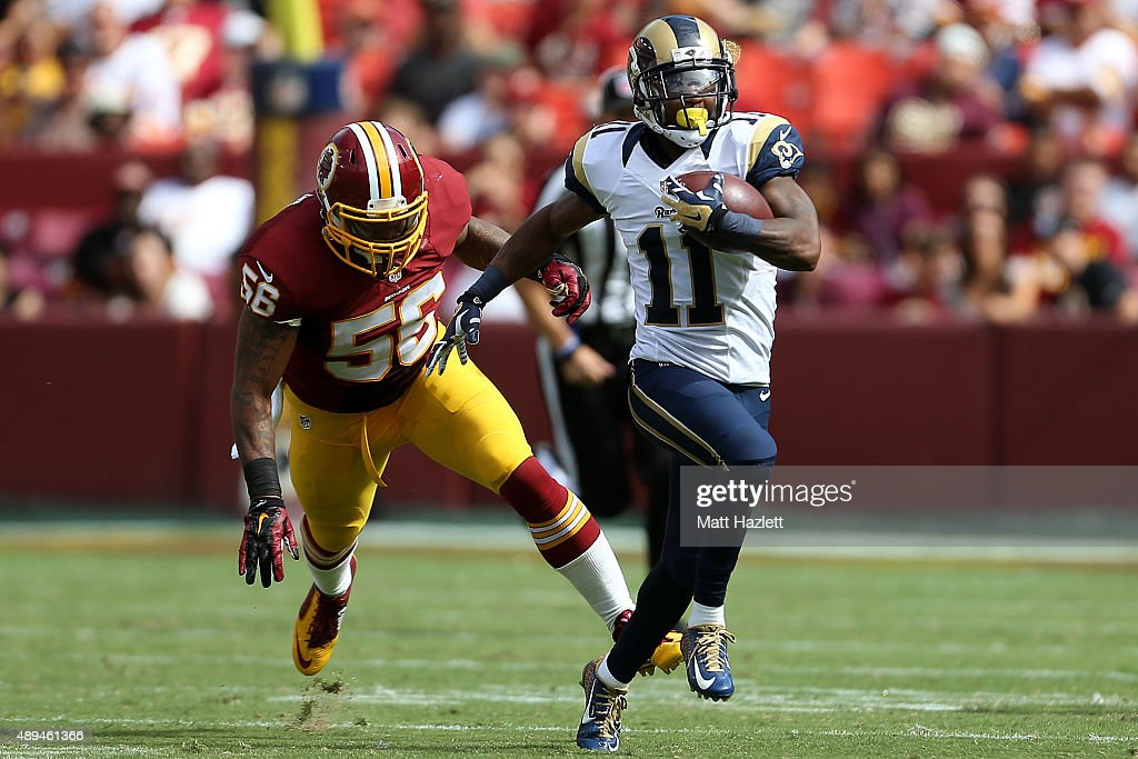 Wide receiver Tavon Austin of the St Louis Rams carries the ball past inside linebacker Perry Riley of the Washington Redskins in the third quarter...