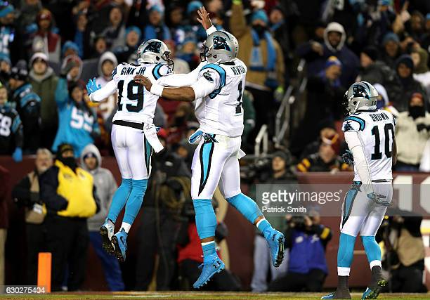 Wide receiver Ted Ginn of the Carolina Panthers celebrates with teammate quarterback Cam Newton of the Carolina Panthers after scoring a first...