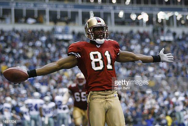 Wide receiver Terrell Owens of the San Francisco 49ers celebrates in the end zone after scoring a touchdown against the Dallas Cowboys with 12...