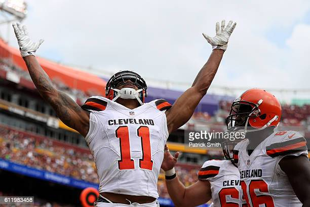 Wide receiver Terrelle Pryor of the Cleveland Browns celebrates with teammate tight end Randall Telfer after scoring a second quarter touchdown...