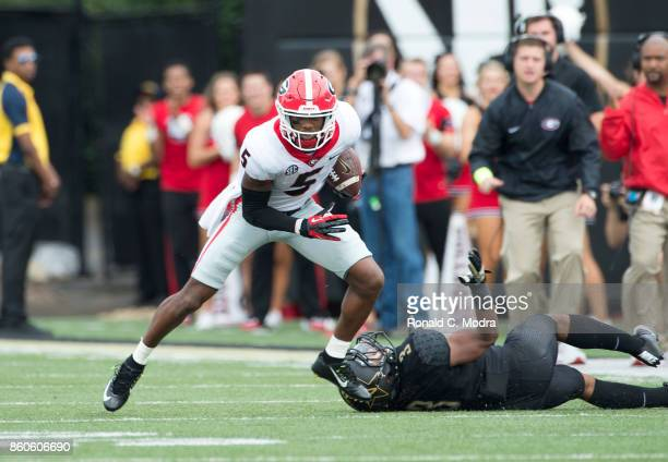 Wide receiver Terry Godwin of the Georgia Bulldogs carries the ball during a game against the Vanderbilt Commodores at Vanderbilt Stadium on October...