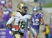Wide receiver Tevin Reese of the Baylor Bears catches a 93yard touchdown pass against the Kansas State Wildcats during the first half on October 12...