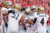 Wide receiver Thomas Duarte of the UCLA Bruins is congratulad by quarterback Josh Rosen and teammates after catching a 35 yard touchdown reception...