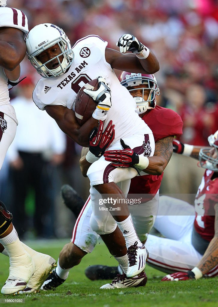 Wide receiver Thomas Johnson #8 of the Texas A&M Aggies is tackled by defensive back Dee Milliner #28 of the Alabama Crimson Tide during the game at Bryant-Denny Stadium on November 10, 2012 in Tuscaloosa, Alabama.