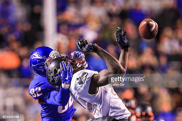 Wide receiver Thomas Sperbeck of the Boise State Broncos breaks up an interception attempt by defensive back Kenny Keys of the UNLV Rebels during...