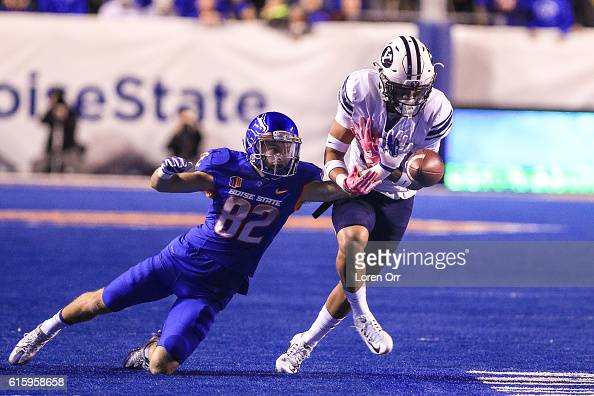 Wide receiver Thomas Sperbeck of the Boise State Broncos makes a defensive play knocking away a pass interception by defensive back Troy Warner of...