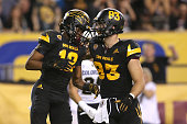 Wide receiver Tim White of the Arizona State Sun Devils celebrates his second quarter touchdown with tight end Kody Kohl during the college football...