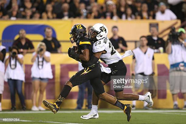Wide receiver Tim White of the Arizona State Sun Devils is hit by defensive back Ahkello Witherspoon of the Colorado Buffaloes in the end zone during...
