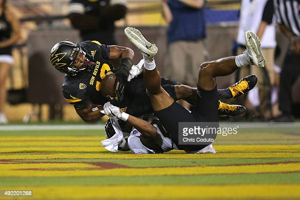 Wide receiver Tim White of the Arizona State Sun Devils is hit by defensive back Ahkello Witherspoon of the Colorado Buffaloes in the end zone for a...