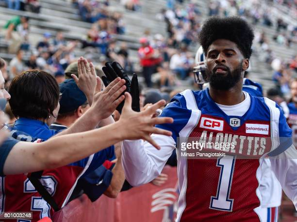 Wide receiver Tiquan Underwood of the Montreal Alouettes greets the fans during the warmup prior to the CFL game against the Saskatchewan Roughriders...