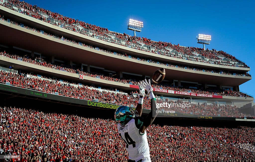 Wide receiver Tony Lippett #14 of the Michigan State Spartans reaches for a ball during their game at against the Nebraska Cornhuskers Memorial Stadium on November 16, 2013 in Lincoln, Nebraska.