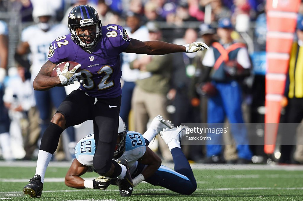 Wide receiver <a gi-track='captionPersonalityLinkClicked' href=/galleries/search?phrase=Torrey+Smith&family=editorial&specificpeople=5527843 ng-click='$event.stopPropagation()'>Torrey Smith</a> #82 of the Baltimore Ravens avoids the tackle of cornerback <a gi-track='captionPersonalityLinkClicked' href=/galleries/search?phrase=Blidi+Wreh-Wilson&family=editorial&specificpeople=6499873 ng-click='$event.stopPropagation()'>Blidi Wreh-Wilson</a> #25 of the Tennessee Titans in the second quarter of a game at M&T Bank Stadium on November 9, 2014 in Baltimore, Maryland.