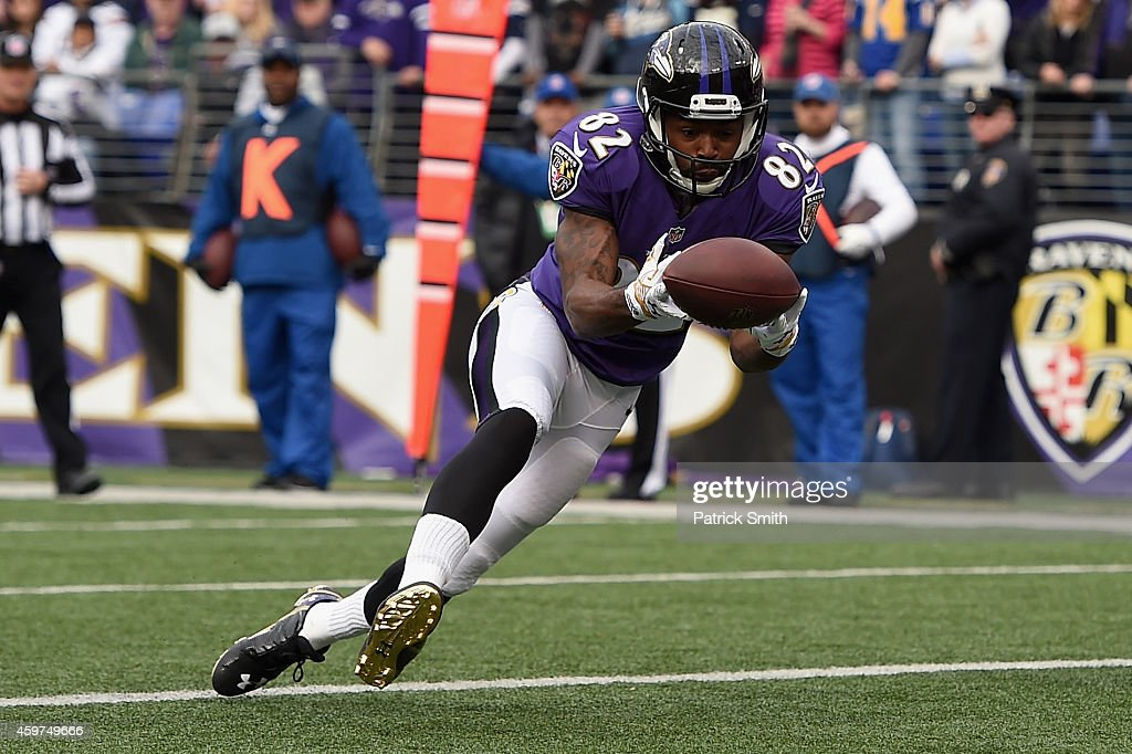 Wide receiver Torrey Smith of the Baltimore Ravens catches a touchdown in the first quarter of a game against the San Diego Chargers at MT Bank...