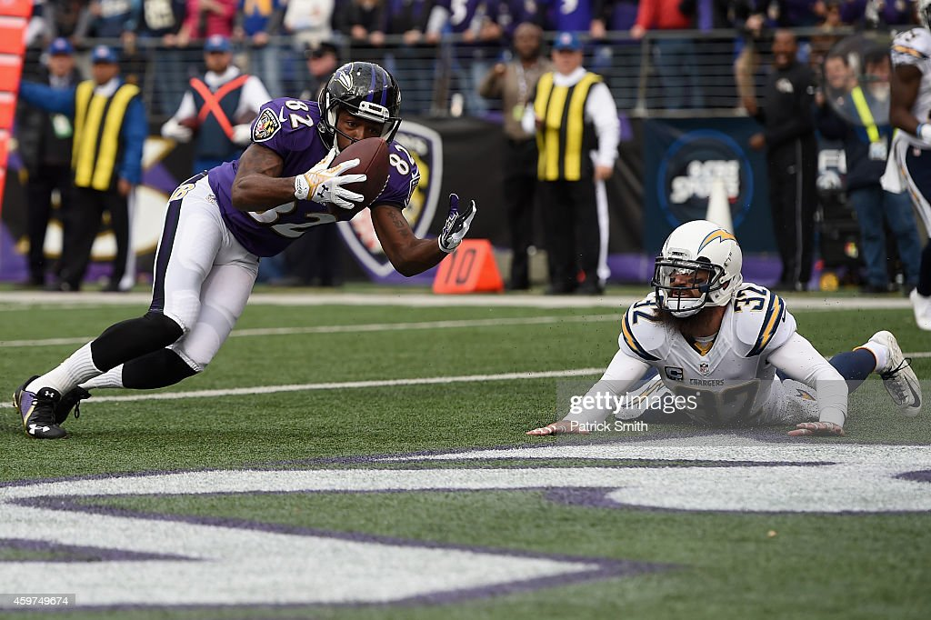 Wide receiver <a gi-track='captionPersonalityLinkClicked' href=/galleries/search?phrase=Torrey+Smith&family=editorial&specificpeople=5527843 ng-click='$event.stopPropagation()'>Torrey Smith</a> #82 of the Baltimore Ravens catches a touchdown over free safety <a gi-track='captionPersonalityLinkClicked' href=/galleries/search?phrase=Eric+Weddle&family=editorial&specificpeople=2630547 ng-click='$event.stopPropagation()'>Eric Weddle</a> #32 of the San Diego Chargers in the first quarter of a game at M&T Bank Stadium on November 30, 2014 in Baltimore, Maryland.