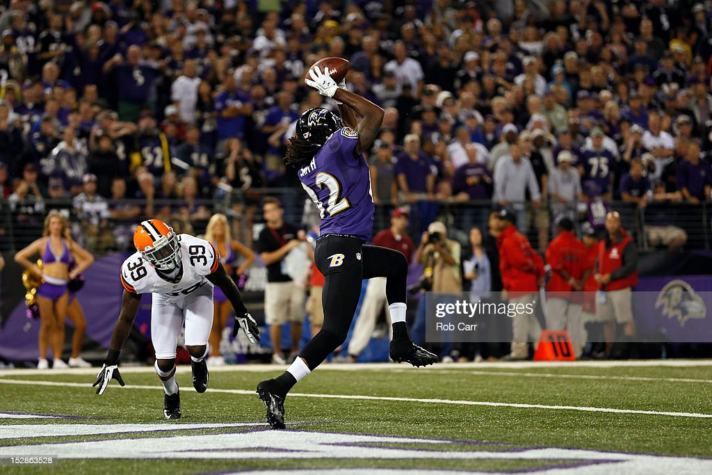 Wide receiver <a gi-track='captionPersonalityLinkClicked' href=/galleries/search?phrase=Torrey+Smith&family=editorial&specificpeople=5527843 ng-click='$event.stopPropagation()'>Torrey Smith</a> #82 of the Baltimore Ravens catches a touchdown pass in the second quarter against cornerback Tashaun Gipson #39 of the Cleveland Browns during the NFL Game at M&T Bank Stadium on September 27, 2012 in Baltimore, Maryland.