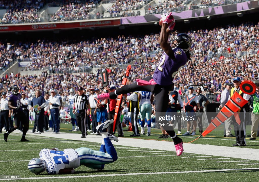 Wide receiver <a gi-track='captionPersonalityLinkClicked' href=/galleries/search?phrase=Torrey+Smith&family=editorial&specificpeople=5527843 ng-click='$event.stopPropagation()'>Torrey Smith</a> #82 of the Baltimore Ravens catches a touchdown pass in front of cornerback <a gi-track='captionPersonalityLinkClicked' href=/galleries/search?phrase=Morris+Claiborne&family=editorial&specificpeople=7173017 ng-click='$event.stopPropagation()'>Morris Claiborne</a> #24 of the Dallas Cowboys during the second quarter at M&T Bank Stadium on October 14, 2012 in Baltimore, Maryland.
