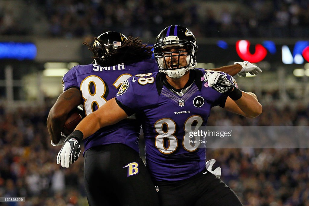 Wide receiver Torrey Smith of the Baltimore Ravens celebrates with his teammate tight end Dennis Pitta after scoring a touchdown in the second...