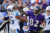 Wide receiver Torrey Smith of the Baltimore Ravens is shoved out of bounds by cornerback Blidi WrehWilson of the Tennessee Titans in the third...