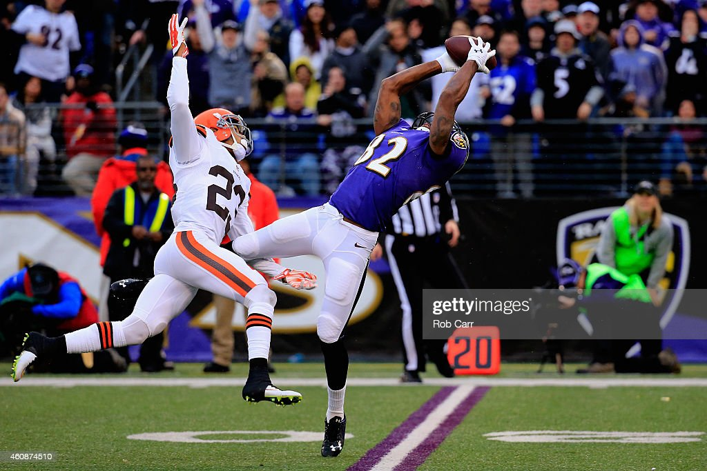 Wide receiver <a gi-track='captionPersonalityLinkClicked' href=/galleries/search?phrase=Torrey+Smith&family=editorial&specificpeople=5527843 ng-click='$event.stopPropagation()'>Torrey Smith</a> #82 of the Baltimore Ravens makes a fourth quarter catch past the defense of cornerback <a gi-track='captionPersonalityLinkClicked' href=/galleries/search?phrase=Joe+Haden&family=editorial&specificpeople=4489430 ng-click='$event.stopPropagation()'>Joe Haden</a> #23 of the Cleveland Browns at M&T Bank Stadium on December 28, 2014 in Baltimore, Maryland.