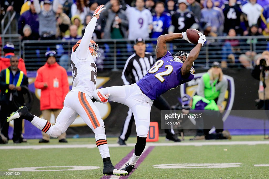 Wide receiver Torrey Smith of the Baltimore Ravens makes a fourth quarter catch past the defense of cornerback Joe Haden of the Cleveland Browns at...
