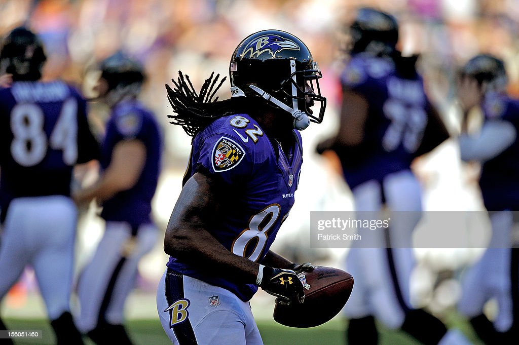 Wide receiver <a gi-track='captionPersonalityLinkClicked' href=/galleries/search?phrase=Torrey+Smith&family=editorial&specificpeople=5527843 ng-click='$event.stopPropagation()'>Torrey Smith</a> #82 of the Baltimore Ravens runs off the field after scoring a touchdown in the third quarter against the Oakland Raiders at M&T Bank Stadium on November 11, 2012 in Baltimore, Maryland. The Baltimore Ravens won, 55-20.