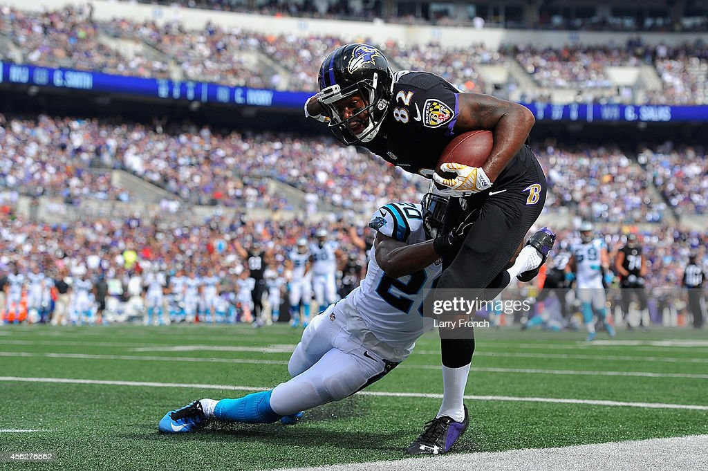 Wide receiver <a gi-track='captionPersonalityLinkClicked' href=/galleries/search?phrase=Torrey+Smith&family=editorial&specificpeople=5527843 ng-click='$event.stopPropagation()'>Torrey Smith</a> #82 of the Baltimore Ravens scores a third quarter touchdown against the Carolina Panthers at M&T Bank Stadium on September 28, 2014 in Baltimore, Maryland.