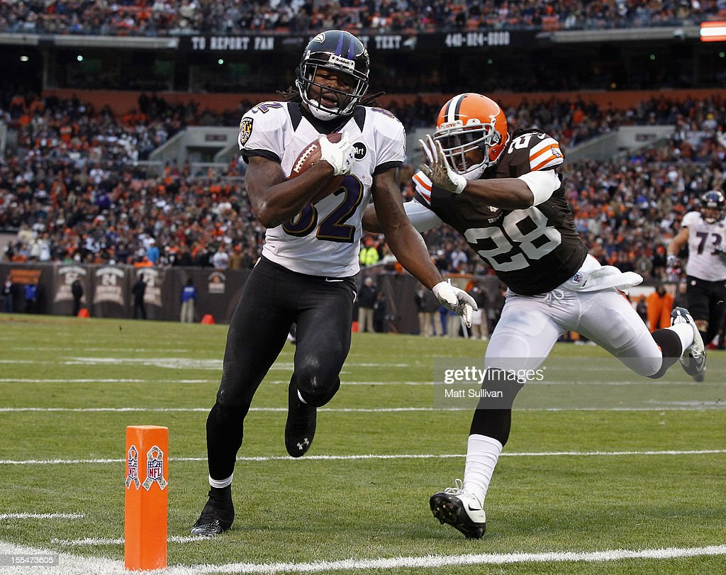 Wide receiver Torrey Smith of the Baltimore Ravens scores a touchdown as he is hit by defensive back Usama Young of the Cleveland Browns at Cleveland...