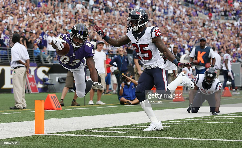 Wide receiver <a gi-track='captionPersonalityLinkClicked' href=/galleries/search?phrase=Torrey+Smith&family=editorial&specificpeople=5527843 ng-click='$event.stopPropagation()'>Torrey Smith</a> #82 of the Baltimore Ravens steps out of bounds while trying to score after catching a pass in front of cornerback <a gi-track='captionPersonalityLinkClicked' href=/galleries/search?phrase=Kareem+Jackson&family=editorial&specificpeople=3908085 ng-click='$event.stopPropagation()'>Kareem Jackson</a> #25 of the Houston Texans during the second half at M&T Bank Stadium on September 22, 2013 in Baltimore, Maryland. The Ravens won 30-9.