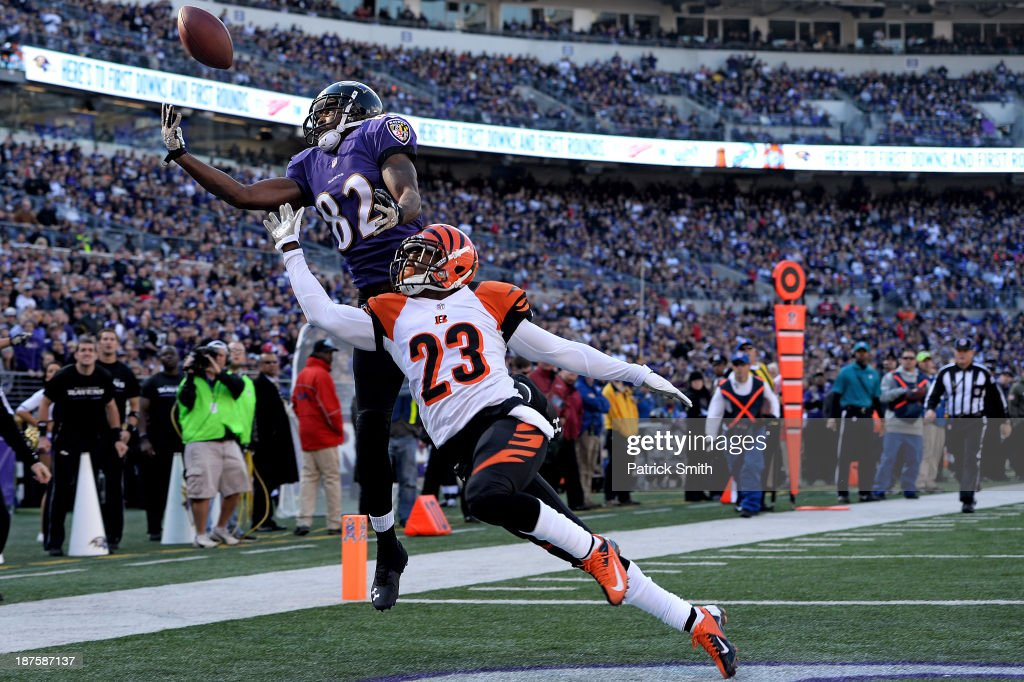 Wide receiver <a gi-track='captionPersonalityLinkClicked' href=/galleries/search?phrase=Torrey+Smith&family=editorial&specificpeople=5527843 ng-click='$event.stopPropagation()'>Torrey Smith</a> #82 of the Baltimore Ravens tries to catch a pass as he is defended by cornerback <a gi-track='captionPersonalityLinkClicked' href=/galleries/search?phrase=Terence+Newman&family=editorial&specificpeople=220965 ng-click='$event.stopPropagation()'>Terence Newman</a> #23 of the Cincinnati Bengals in the first quarter at M&T Bank Stadium on November 10, 2013 in Baltimore, Maryland.