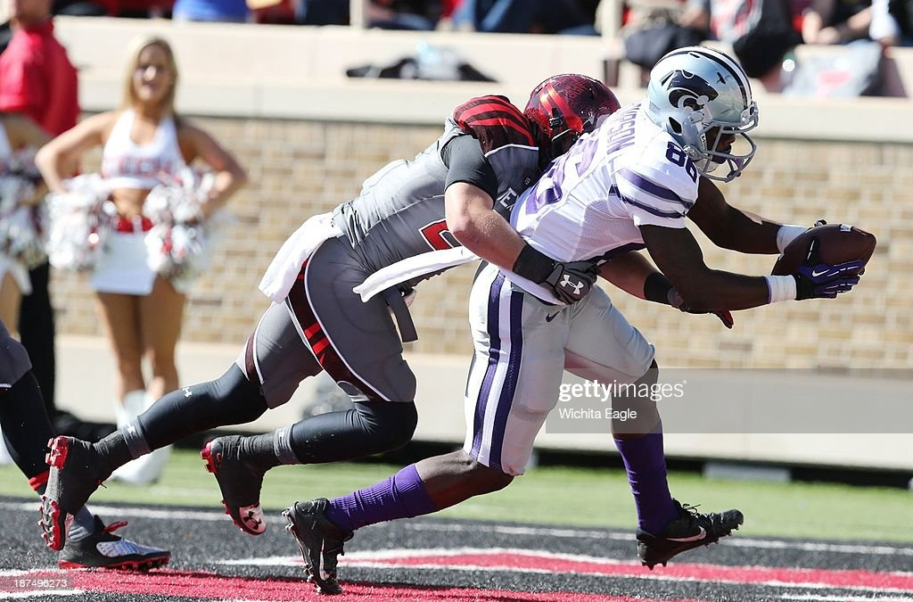 Wide receiver Tramaine Thompson (86) of Kansas State pulls in a 20-yard Jake Waters pass for a touchdown against Texas Tech at Jones AT&T Stadium in Lubbock, Texas, on Saturday, Nov. 9, 2013. K-State won, 49-26.