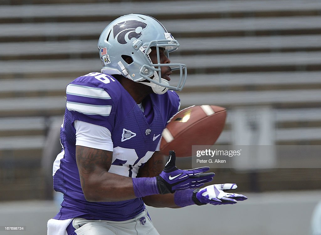 Wide receiver Tramaine Thompson #86 of the Kansas State Wildcats catches a touchdown pass during the Purple and White Spring Game on April 27, 2013 at Bill Snyder Family Stadium in Manhattan, Kansas.