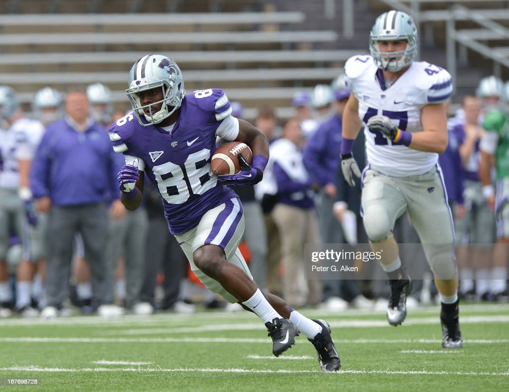 Wide receiver Tramaine Thompson #86 of the Kansas State Wildcats rushes up field after catching a pass during the Purple and White Spring Game on April 27, 2013 at Bill Snyder Family Stadium in Manhattan, Kansas.