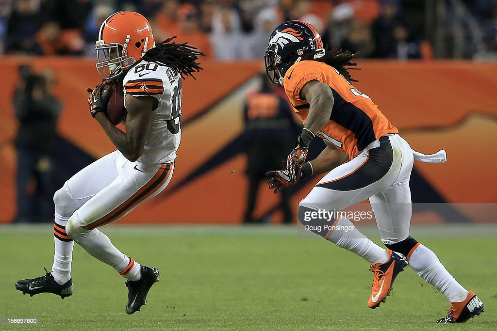 Wide receiver Travis Benjamin #80 of the Cleveland Browns makes a reception as cornerback Omar Bolden #31 of the Denver Broncos defends at Sports Authority Field at Mile High on December 23, 2012 in Denver, Colorado. The Broncos defeated the Browns 34-12.
