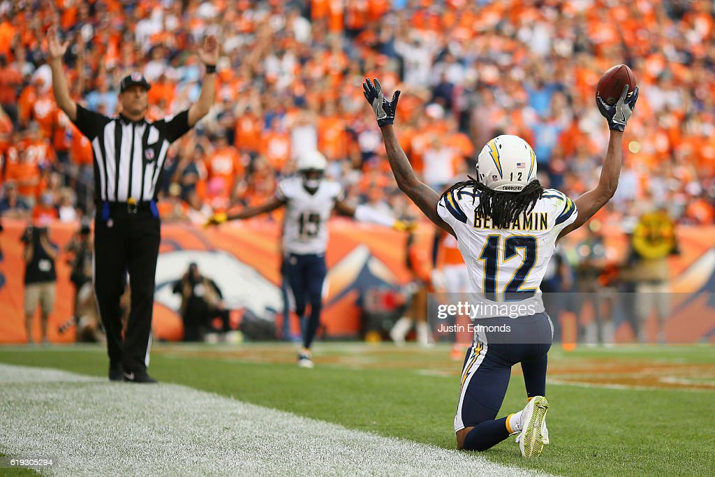 Wide receiver Travis Benjamin #12 of the San Diego Chargers celebrates a touchdown in the third quarter of the game against the Denver Broncos at Sports Authority Field at Mile High on October 30, 2016 in Denver, Colorado.