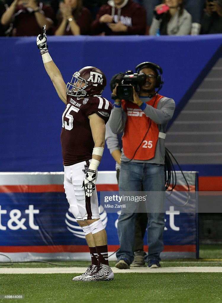 Wide receiver Travis Labhart #15 of the Texas A&M Aggies celebrates after a touchdown during the Chick-fil-A Bowl game against the Duke Blue Devils at the Georgia Dome on December 31, 2013 in Atlanta, Georgia.