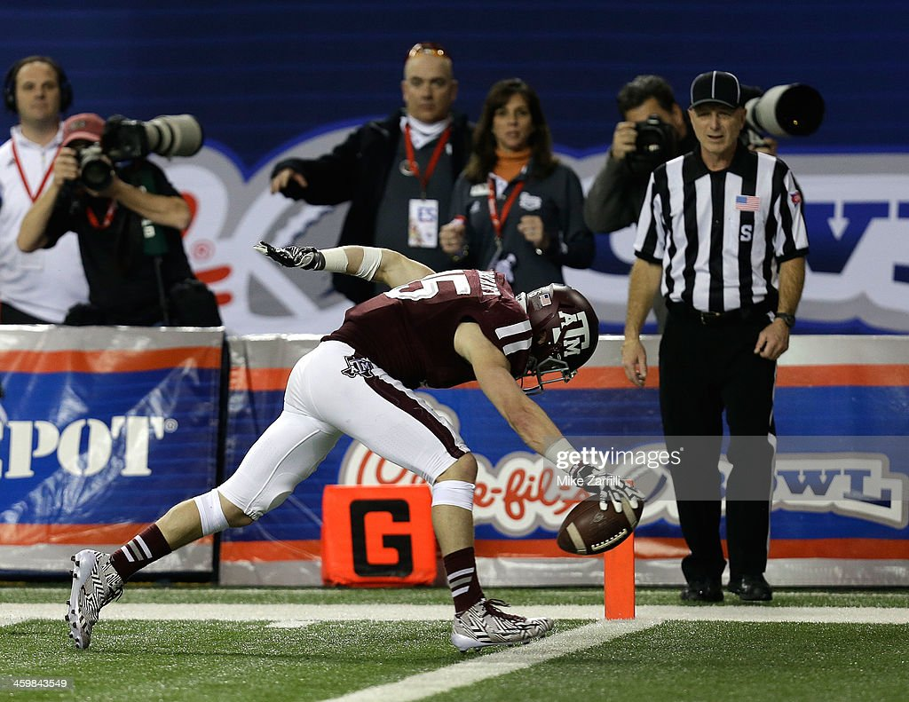Wide receiver Travis Labhart #15 of the Texas A&M Aggies stretches across the goal line for a touchdown during the Chick-fil-A Bowl game against the Duke Blue Devils at the Georgia Dome on December 31, 2013 in Atlanta, Georgia.