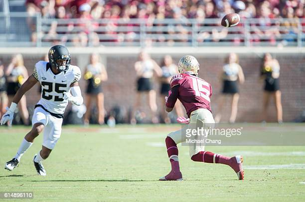 Wide receiver Travis Rudolph of the Florida State Seminoles catches a pass in front of defensive back Brad Watson of the Wake Forest Demon Deacons at...