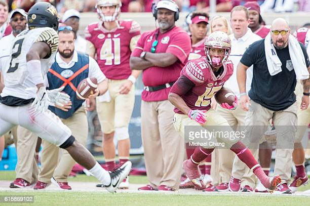 Wide receiver Travis Rudolph of the Florida State Seminoles looks to maneuver by defensive back Cameron Glenn of the Wake Forest Demon Deacons at...
