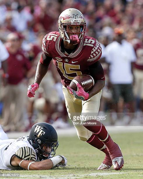 Wide Receiver Travis Rudolph of the Florida State Seminoles makes a catch and run during the game against the Wake Forest Demon Deacons at Doak...