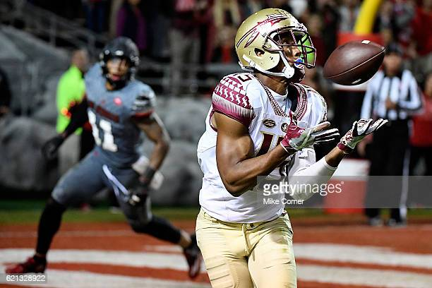 Wide receiver Travis Rudolph of the Florida State Seminoles makes a touchdown reception against the North Carolina State Wolfpack at CarterFinley...