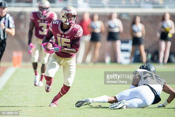Wide receiver Travis Rudolph of the Florida State Seminoles runs the ball by defensive back Brad Watson of the Wake Forest Demon Deacons at Doak...