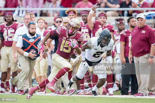 Wide receiver Travis Rudolph of the Florida State Seminoles runs the ball by defensive back Cameron Glenn of the Wake Forest Demon Deacons at Doak...