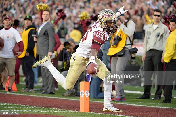 Wide receiver Travis Rudolph of the Florida State Seminoles scores on a 18yard pass from quarterback Jameis Winston in the third quarter of the...