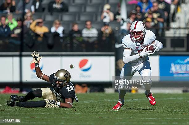 Wide receiver Trenton Irwin of the Stanford Cardinal runs after a catch against defensive back Ahkello Witherspoon of the Colorado Buffaloes at...