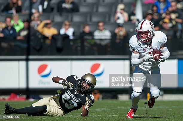 Wide receiver Trenton Irwin of the Stanford Cardinal runs after a catch afainst defensive back Ahkello Witherspoon of the Colorado Buffaloes at...