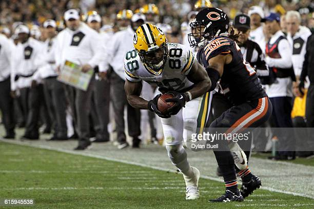 Wide receiver Ty Montgomery of the Green Bay Packers is tackled by cornerback Cre'von LeBlanc of the Chicago Bears in the first quarter at Lambeau...