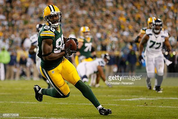 Wide receiver Ty Montgomery of the Green Bay Packers runs with the football after a reception against the Seattle Seahawks during the fourth quarter...