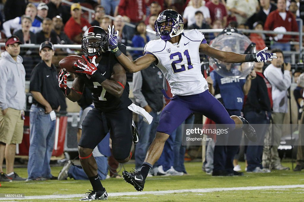 Wide receiver Ty Montgomery #7 of the Stanford Cardinal catches the ball for a touchdown as defensive back Marcus Peters #21 of the Washington Huskies defends during the second quarter of their game on October 5, 2013 at Stanford Stadium in Stanford, California.